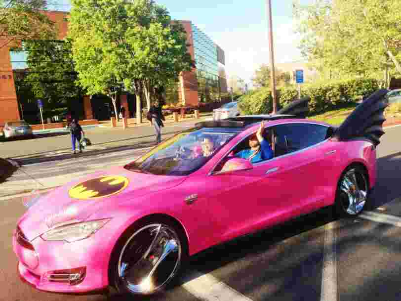 This Is A Photo Of Sergey Brin Wearing Google Glass And Driving A Pink Tesla Decorated Like The Batmobile