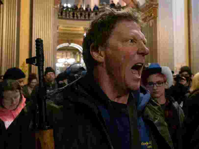 Because of Michigan's gun laws, protesters were allowed to carry their assault weapons into the state capitol -but not their protest signs