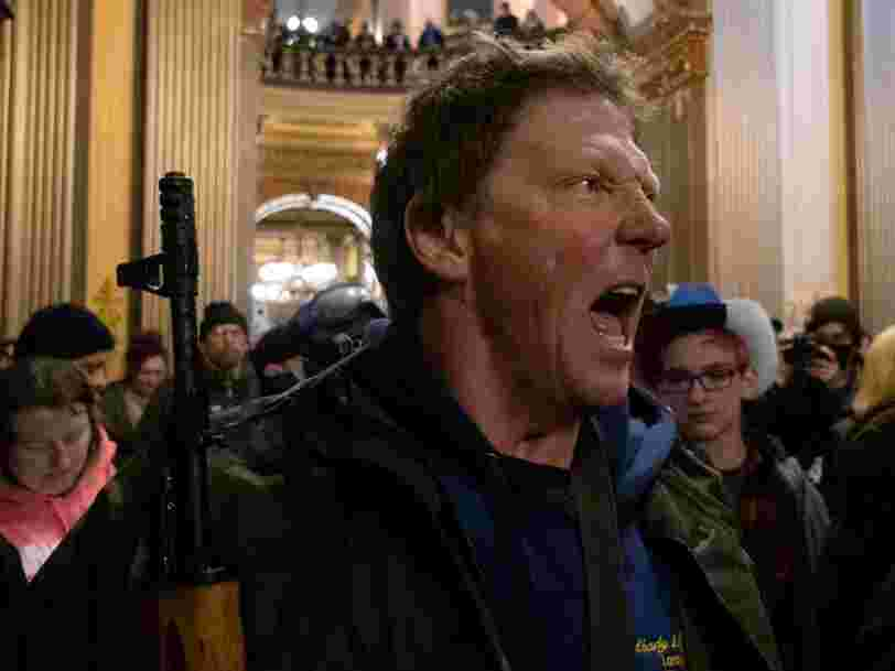 Because of Michigan's gun laws, protesters were allowed to carry their assault weapons into the state capitol —but not their protest signs