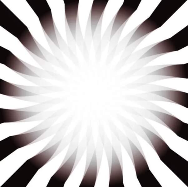 Rapprochez votre tête vers l'image et la lumière au milieu sera plus lumineuse. Éloignez là et la lumière deviendra plus faible.